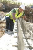 Construction Worker Laying Foundations Stock Images