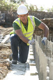 Construction Worker Laying Foundations Royalty Free Stock Photo