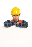 Construction worker lean on banner. Stock Photography