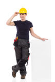 Construction worker lean on blank placard Stock Image