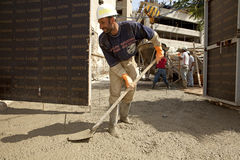 Construction worker, Lebanon. Construction worker mixing cement in Lebanon Stock Photo