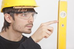 Construction worker with level Stock Photography