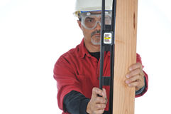 Construction Worker with Level and Board Stock Images