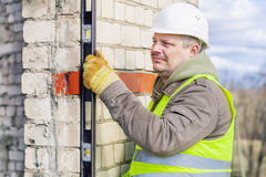 Construction worker with level near wall Stock Photography