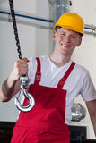 Construction worker and lifting equipment Royalty Free Stock Photography