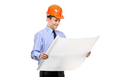 Construction worker looking at blueprints Stock Images