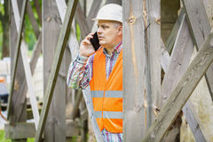 Construction worker looking through scaffolding Royalty Free Stock Photos