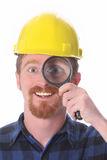 Construction worker with loupe Royalty Free Stock Photo