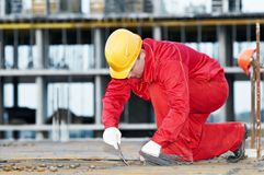 Construction worker making stock photography
