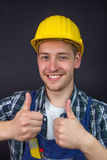 Construction worker making thumbs up sign Royalty Free Stock Photo