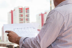 A construction worker man holding in hands blueprints Stock Image