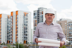 A construction worker man in white helmet holding Royalty Free Stock Images