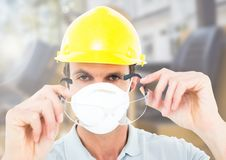 Construction Worker with mask in front of construction site Stock Photos