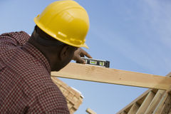 Construction Worker Measuring Level Stock Photo