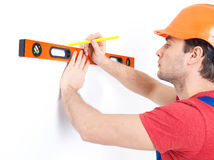 Construction worker measuring the level Stock Photography