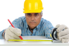 Construction Worker Measuring and Marking Royalty Free Stock Images
