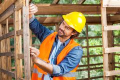 Construction Worker Measuring Timber Frame Royalty Free Stock Images