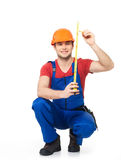 Construction worker measuring the wall Stock Images