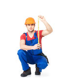 Construction worker measuring the wall royalty free stock photo