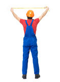 Construction worker measuring the wall Royalty Free Stock Photos