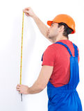 Construction worker measuring the wall Royalty Free Stock Photography