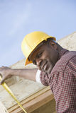Construction Worker Measuring Wooden Beam Royalty Free Stock Photo