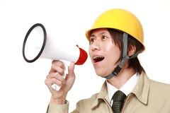 Construction worker with megaphone Stock Image