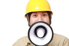Construction worker with megaphone Royalty Free Stock Photo