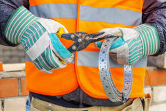 Construction worker with metal Cutting shears and mounting tape Stock Images