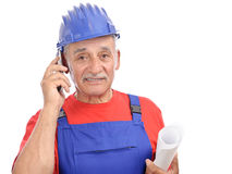 Construction worker mobile phone Stock Images