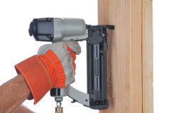 Construction Worker and Nail Gun Stock Image