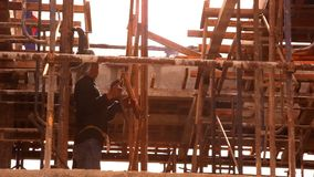 Construction worker a nail with a hammer stock video footage