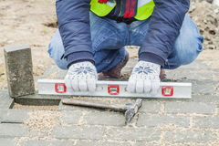 Construction worker near unfinished pavement Royalty Free Stock Image