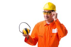 The construction worker with noise cancelling earphones. Construction worker with noise cancelling earphones stock photo