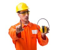 The construction worker with noise cancelling earphones. Construction worker with noise cancelling earphones royalty free stock images