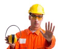 Construction worker with noise cancelling earphones. The construction worker with noise cancelling earphones royalty free stock photography