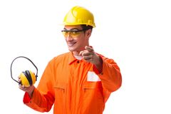 The construction worker with noise cancelling earphones. Construction worker with noise cancelling earphones royalty free stock photos