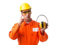 The construction worker with noise cancelling earphones. Construction worker with noise cancelling earphones royalty free stock image