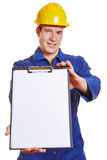 Construction worker offering Stock Image