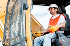 Construction worker operating a crane Stock Photography