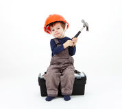 Construction worker in orange helmet with hammer sitting Stock Photography