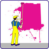 Construction worker with paint on the wall Stock Images