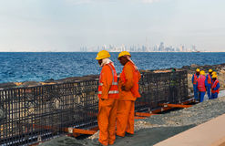 Construction worker at Palm Jumeirah of Persian Gulf. Stock Image
