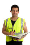 Construction worker with pen and book stock photography