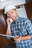 Construction worker on phone Royalty Free Stock Photos