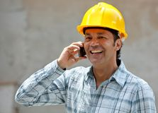 Construction worker on the phone Royalty Free Stock Images