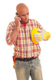 Construction worker at the phone Stock Photography