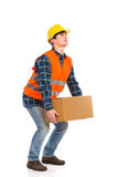 Construction worker picking up heavy box. Full length studio shot isolated on white Royalty Free Stock Images