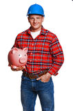 Construction worker with piggy bank. Stock Image