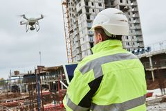 Drone operated by construction worker on building site Stock Photography